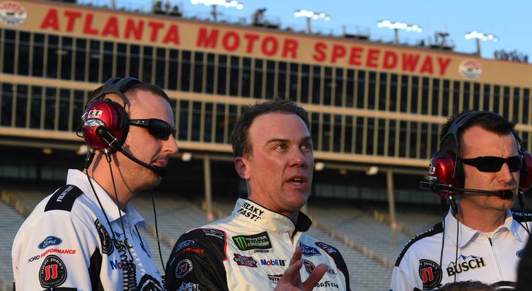 Feb 23, 2018; Hampton, GA, USA; Monster Energy NASCAR Cup Series driver Kevin Harvick (middle) talks with his crew during qualifying for the Folds of Honor QuikTrip 500 at Atlanta Motor Speedway.