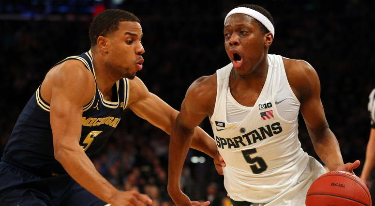 Mar 3, 2018; New York, NY, USA; Michigan State Spartans guard Cassius Winston (5) controls the ball against Michigan Wolverines guard Jaaron Simmons (5) during the second half of a semifinal game of the 2018 Big Ten Tournament at Madison Square Garden.