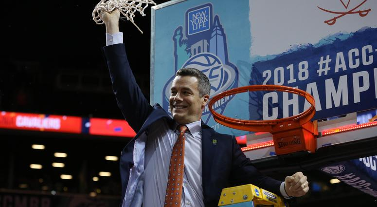 Mar 10, 2018; New York, NY, USA; Virginia Cavaliers head coach Tony Bennett cuts the nets after defeating the North Carolina Tar Heels in the championship game of the 2018 ACC tournament at Barclays Center.