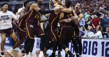 Mar 17, 2018; Dallas, TX, USA; Loyola (Il) Ramblers guard Clayton Custer (13) celebrates with teammates after hitting the game-winning shot to defeat the Tennessee Volunteers in the second round of the 2018 NCAA Tournament at American Airlines Center.