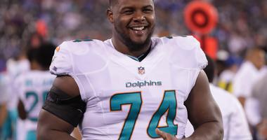 Aug 12, 2016; East Rutherford, NJ, USA; Miami Dolphins tackle Jermon Bushrod (74) during the second half of the preseason game against the New York Giants at MetLife Stadium. The Dolphins won, 27-10.
