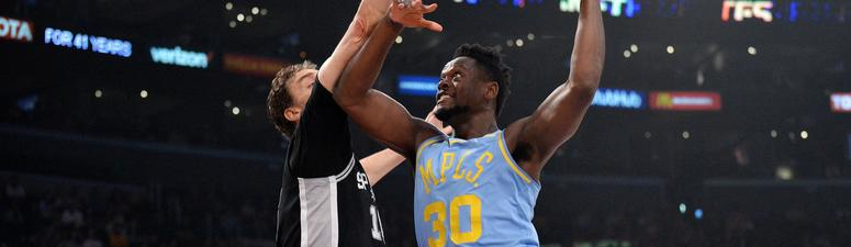 April 4, 2018; Los Angeles, CA, USA; Los Angeles Lakers forward Julius Randle (30) moves to the basket against San Antonio Spurs center Pau Gasol (16) during the first half at Staples Center.