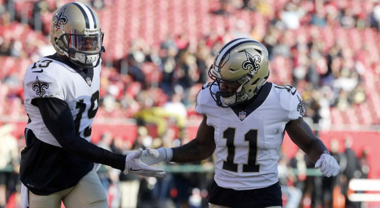 Dec 31, 2017; Tampa, FL, USA; New Orleans Saints wide receiver Ted Ginn (19) and wide receiver Tommylee Lewis (11) work out prior to the game against the Tampa Bay Buccaneers at Raymond James Stadium.