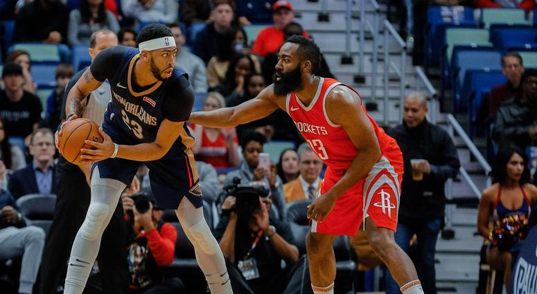 Jan 26, 2018; New Orleans, LA, USA; New Orleans Pelicans forward Anthony Davis (23) is defended by Houston Rockets guard James Harden (13) during the first quarter at the Smoothie King Center