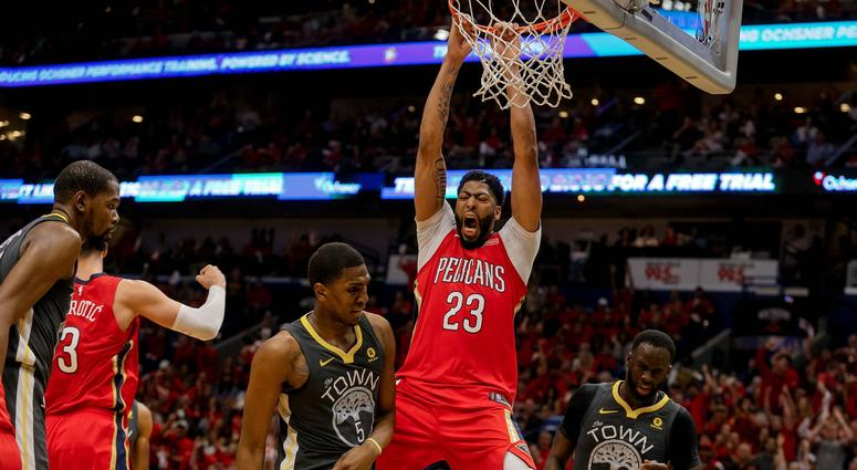 May 4, 2018; New Orleans, LA, USA; New Orleans Pelicans forward Anthony Davis (23) dunks over Golden State Warriors forward Draymond Green (23) and forward Kevon Looney (5) during the third quarter in game three of the second round of the 2018 NBA Playoff