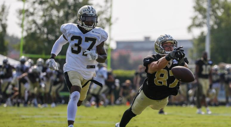 Jul 28, 2018; Metairie, LA, USA; New Orleans Saints wide receiver Josh Smith (87) drops a pass as cornerback Arthur Maulet (37) defends during training camp at New Orleans Saints Training Facility.