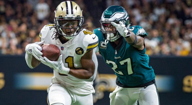 Nov 18, 2018; New Orleans, LA, USA; New Orleans Saints running back Alvin Kamara (41) runs the ball against Philadelphia Eagles strong safety Malcolm Jenkins (27) at the Mercedes-Benz Superdome