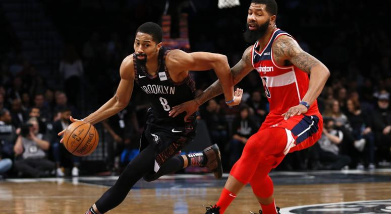 Dec 14, 2018; Brooklyn, NY, USA; Brooklyn Nets guard Spencer Dinwiddie (8) drives to the basket against Washington Wizards forward Markieff Morris (5) during the second half at Barclays Center.