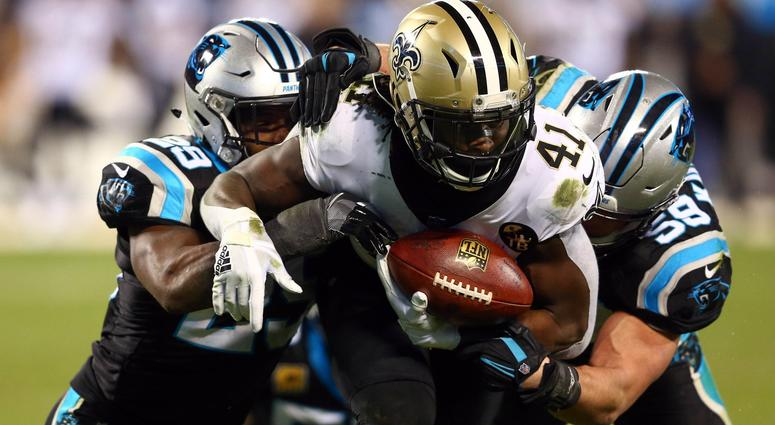 Dec 17, 2018; Charlotte, NC, USA; New Orleans Saints running back Alvin Kamara (41) gets tackled by Carolina Panthers middle linebacker Luke Kuechly (59) and free safety Mike Adams (29) during the fourth quarter at Bank of America Stadium.