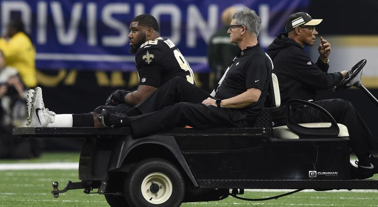 Jan 13, 2019; New Orleans, LA, USA; New Orleans Saints defensive tackle Sheldon Rankins (98) is carted from the field after suffering an apparent injury during the first quarter of a NFC Divisional playoff football game against the Philadelphia Eagles at