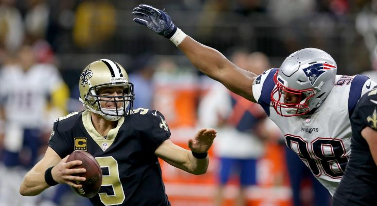 Saints QB Drew Brees avoids a sack against the Patriots