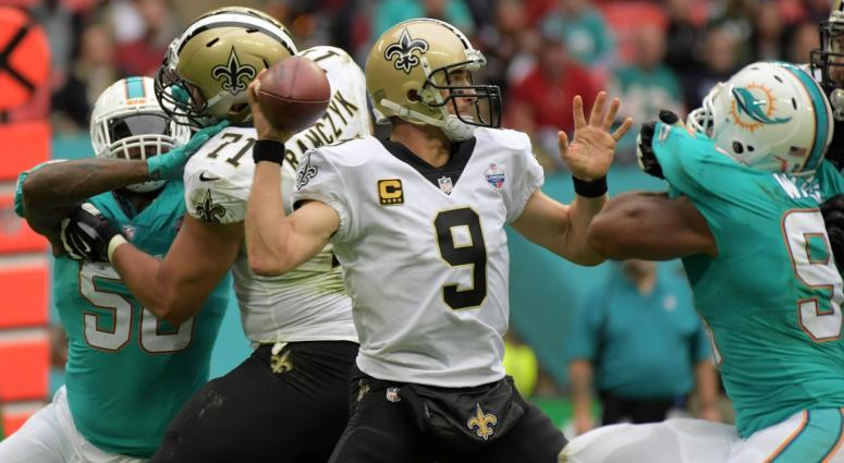 Oct 1, 2017; London, United Kingdom; New Orleans Saints quarterback Drew Brees (9) throws a pass against the Miami Dolphins during a NFL International Series game at Wembley Stadium. The Saints defeated the Dolphins 20-0.