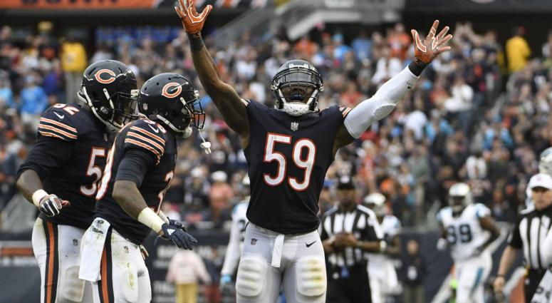 Oct 22, 2017; Chicago, IL, USA; Chicago Bears inside linebacker Danny Trevathan (59) celebrates his interception against the Carolina Panthers during the second half at Soldier Field.