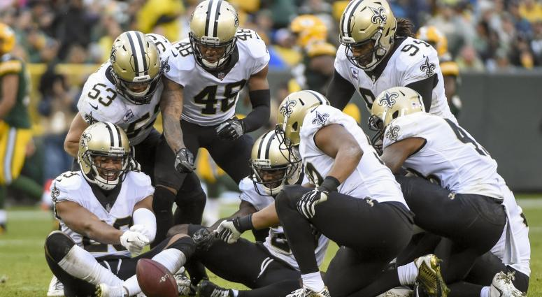 Oct 22, 2017; Green Bay, WI, USA; New Orleans Saints players celebrates after an interception by safety Kenny Vaccaro (32) in the fourth quarter during the game against the Green Bay Packers at Lambeau Field.