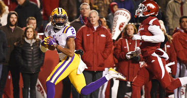 LSU survives with 24-17 win at Arkansas