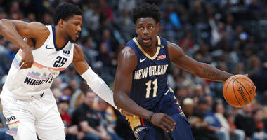 Holiday scores 29, Pelicans beat Nuggets 120-112
