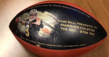Drew Brees gives out customized game balls to those who helped him break passing record