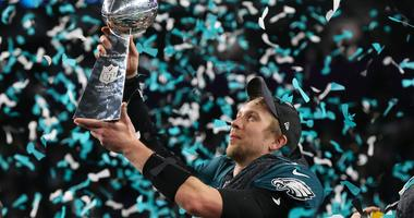 Feb 4, 2018; Minneapolis, MN, USA; Philadelphia Eagles quarterback Nick Foles (9) hoist the Vince Lombardi Trophy after a victory against the New England Patriots in Super Bowl LII at U.S. Bank Stadium