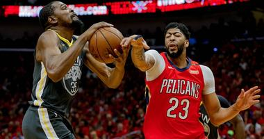 May 6, 2018; New Orleans, LA, USA; New Orleans Pelicans forward Anthony Davis (23) knocks a ball away from Golden State Warriors forward Kevin Durant (35) during the first quarter in game four of the second round of the 2018 NBA Playoffs at the Smoothie K