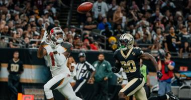 Sep 9, 2018; New Orleans, LA, USA; Tampa Bay Buccaneers wide receiver DeSean Jackson (11) catches a touchdown over New Orleans Saints cornerback Ken Crawley (20) during the fourth quarter of a game at the Mercedes-Benz Superdome. The Buccaneers defeated t