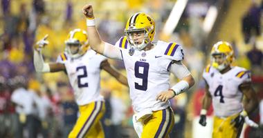Sep 29, 2018; Baton Rouge, LA, USA; LSU Tigers quarterback Joe Burrow (9) celebrates a touchdown against the Mississippi Rebels during the second half of a game at Tiger Stadium.