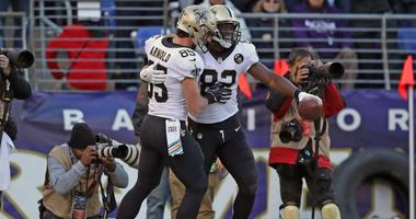 Oct 21, 2018; Baltimore, MD, USA; New Orleans Saints tight end Ben Watson (82) is congratulated by Dan Arnold (85) after catching Drew Brees 500th career touchdown pass during the game against the Baltimore Ravens at M&T Bank Stadium.