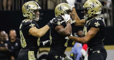 Nov 4, 2018; New Orleans, LA, USA; New Orleans Saints wide receiver Michael Thomas (13) pulls out a cell phone to celebrate a touchdown along with teammates wide receiver Austin Carr (80) and wide receiver Tre'Quan Smith (10) during the fourth quarter aga