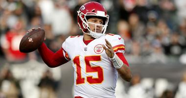 Dec 2, 2018; Oakland, CA, USA; Kansas City Chiefs quarterback Patrick Mahomes (15) prepares to throw a pass against the Oakland Raiders in the third quarter at Oakland Coliseum.