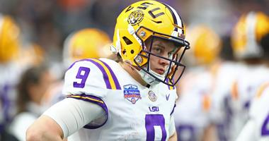 Jan 1, 2019; Glendale, AZ, USA; Louisiana State Tigers quarterback Joe Burrow against the Central Florida Knights in the 2019 Fiesta Bowl at State Farm Stadium.