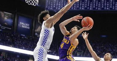 Feb 12, 2019; Lexington, KY, USA; LSU Tigers guard Skylar Mays (4) shoots the ball against Kentucky Wildcats forward Nick Richards (4) in the first half at Rupp Arena.