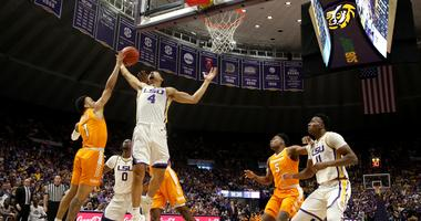 Feb 23, 2019; Baton Rouge, LA, USA; Tennessee Volunteers guard Lamonte Turner (1) and LSU Tigers guard Skylar Mays (4) fight for a rebound in the first half at the Maravich Assembly Center