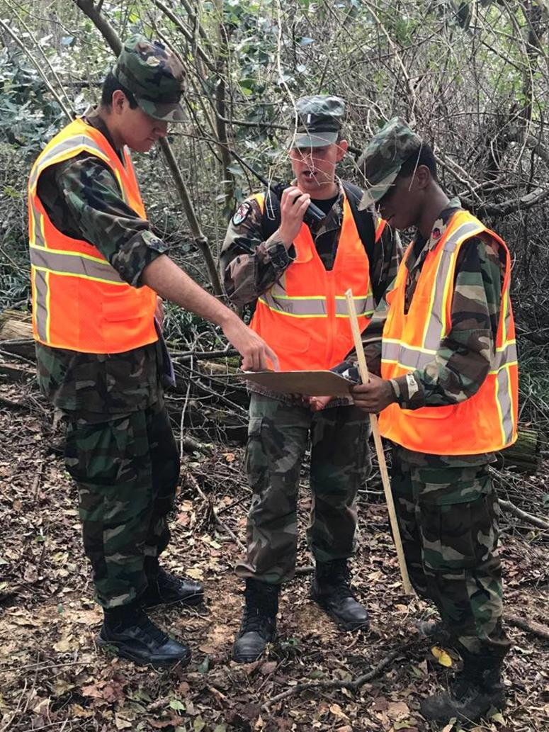 Cadets of the Camden Military Academy Cadet Squadron, assist as part of a ground team effort to record the high-water marks for FEMA