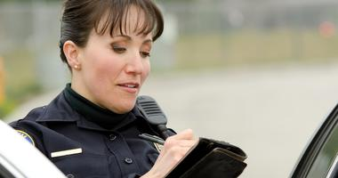 female police officer writing a ticket