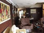 Sala TV acesso garagem