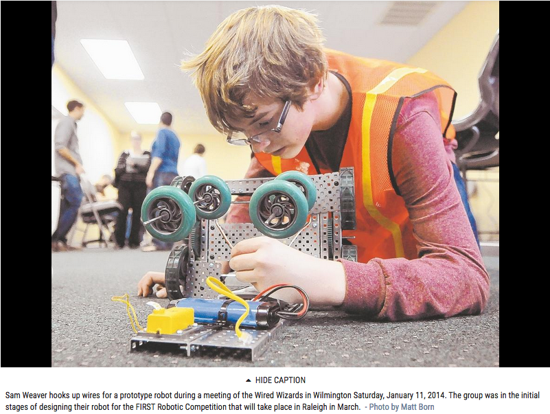 Wired Wizards member building a robot from the Wilmington Morning Star paper