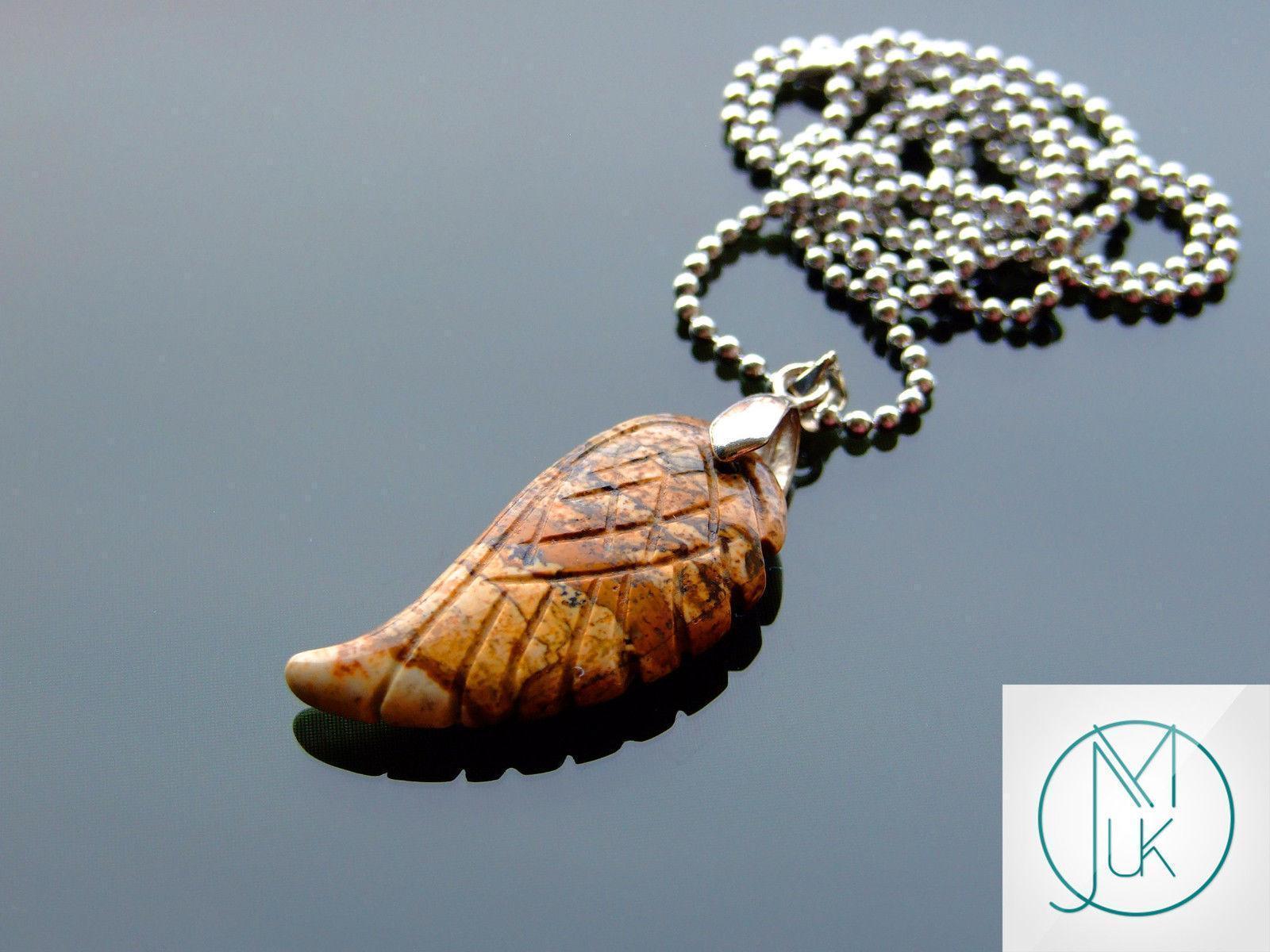 Ange Howlite blue wing pendant