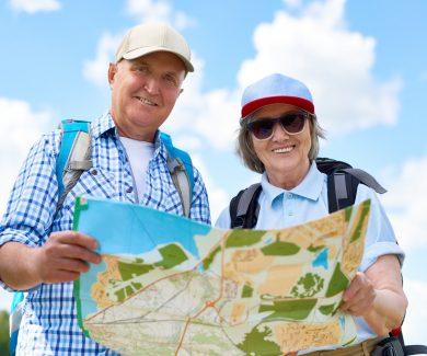 Happy Senior Tourists Holding Map