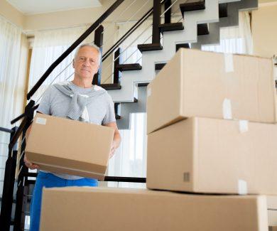 Senior Man Packing Boxes