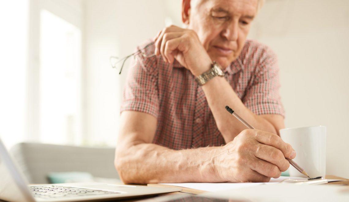Senior Man Writing at Home