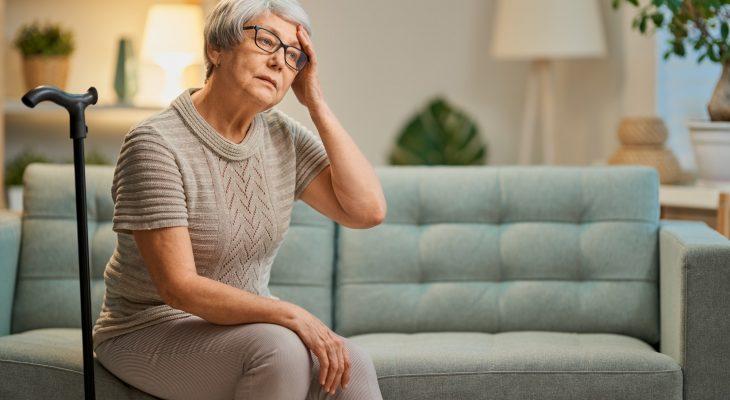 elderly woman isn't feeling well
