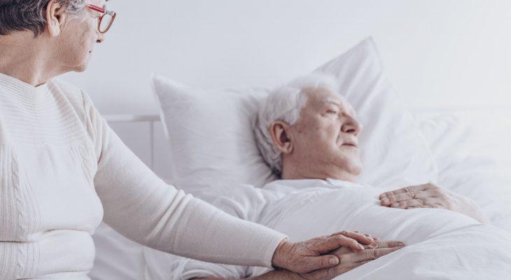 Elderly woman visiting sick husband