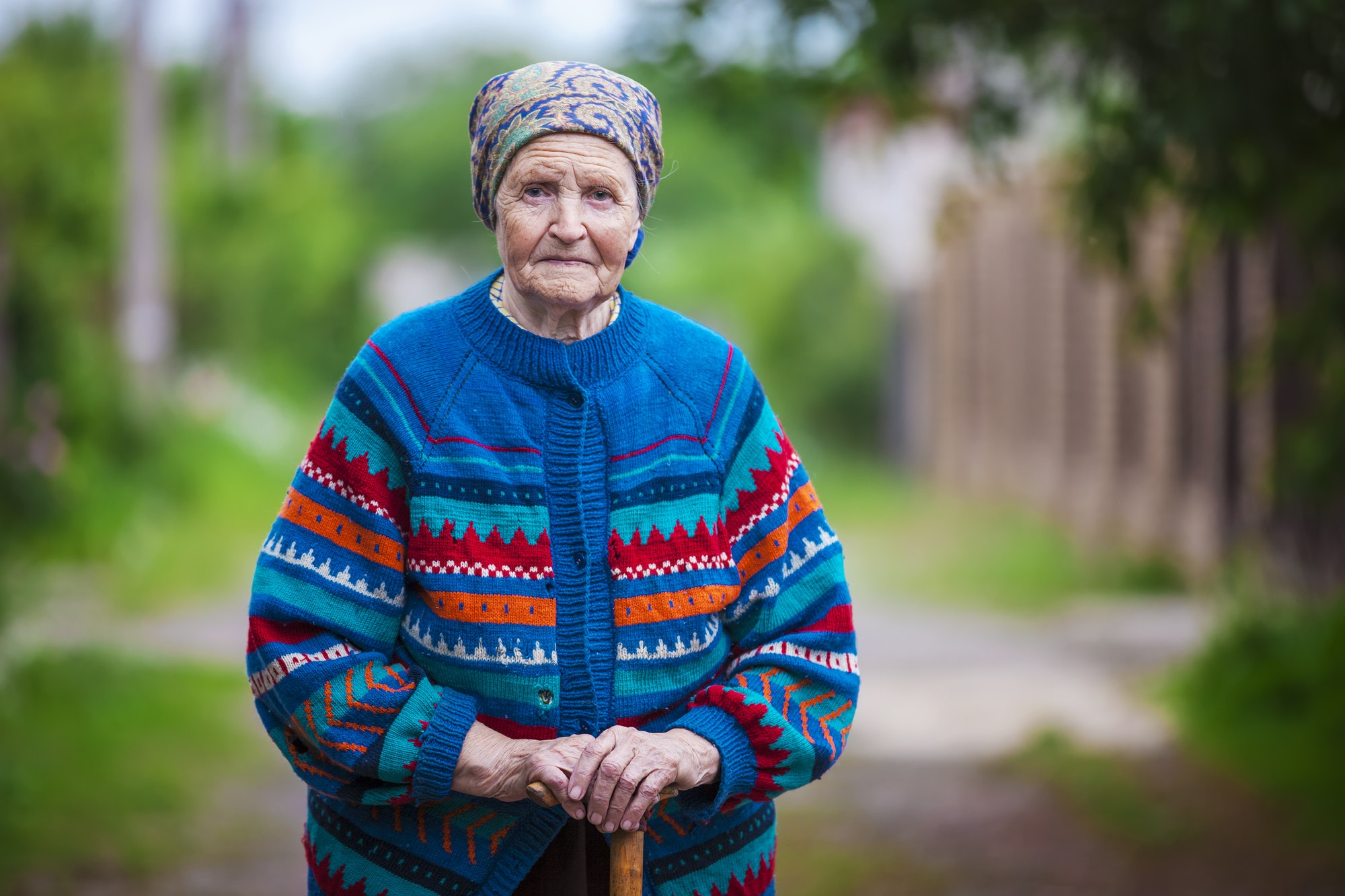Portrait of an aged woman outdoors