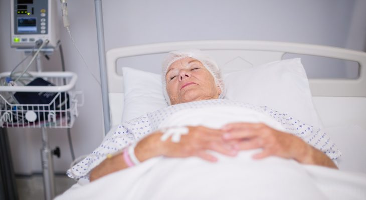 Senior woman patient lying on bed