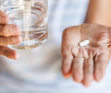 Senior woman taking her daily medication