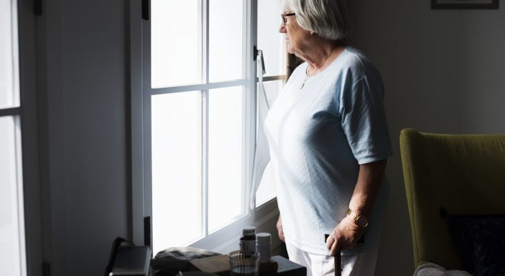 Senior woman standing alone at home