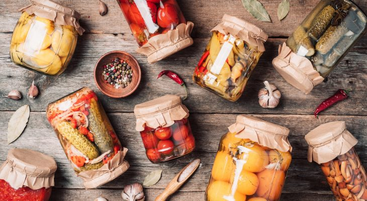 Сucumber, squash and tomatoes pickling and canning into glass jars. Ingredients for vegetables