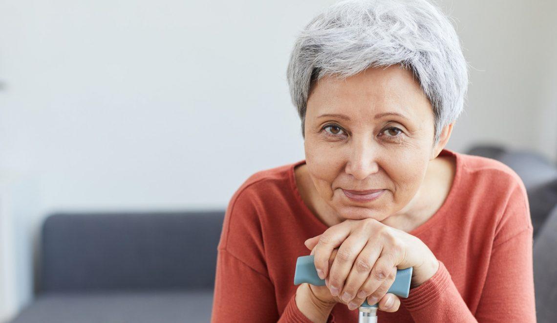 Senior woman with grey hair at home