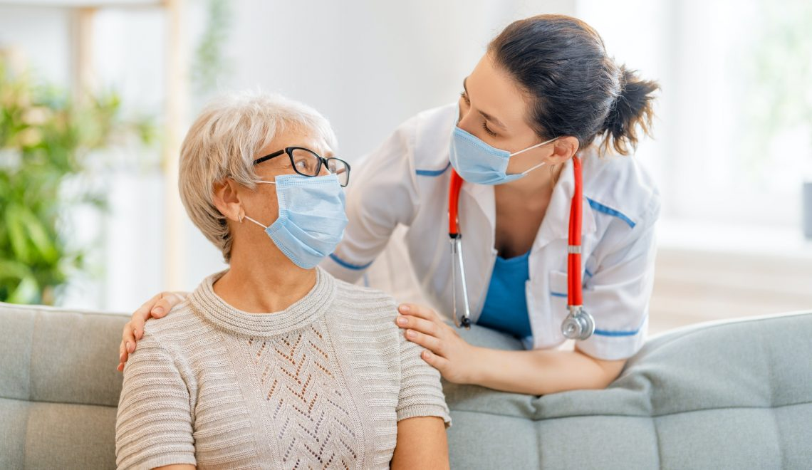 Doctor and senior woman wearing facemasks