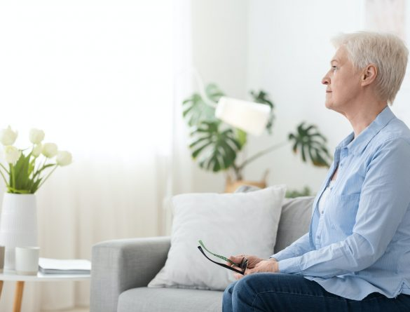 Post-Retirement Depression. Sad Pensive Senior Woman Sitting Alone At Home, Looking Aside