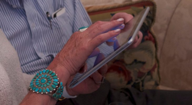 Older couple playing on iPad